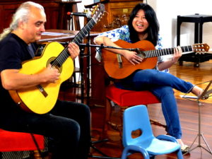 Guitar lessons and the baby chair Melbourne Creative Guitar School event - concert